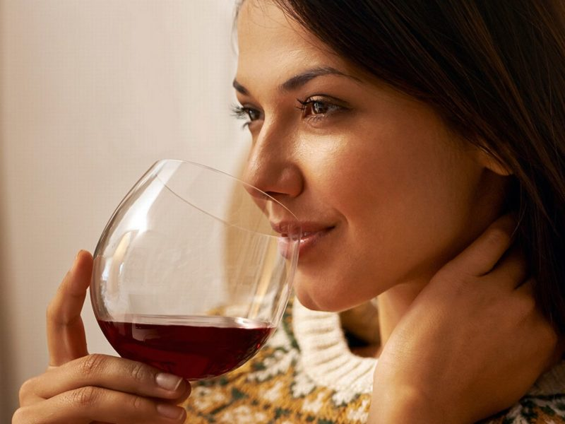 Woman-enjoying-a-glass-of-wine-while-relaxing-